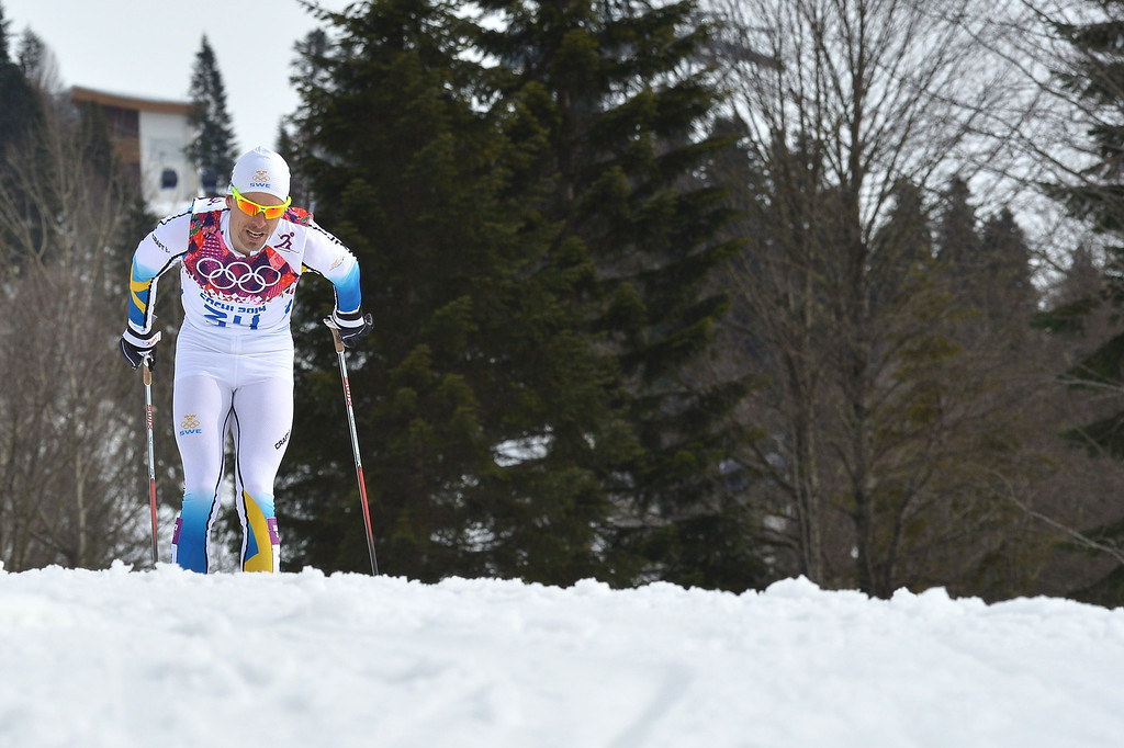. Silver medalist Sweden\'s Johan Olsson competes in the Men\'s Cross-Country Skiing 15km Classic at the Laura Cross-Country Ski and Biathlon Center during the Sochi Winter Olympics on February 14, 2014 in Rosa Khutor near Sochi.  AFP PHOTO / ALBERTO PIZZOLI/AFP/Getty Images