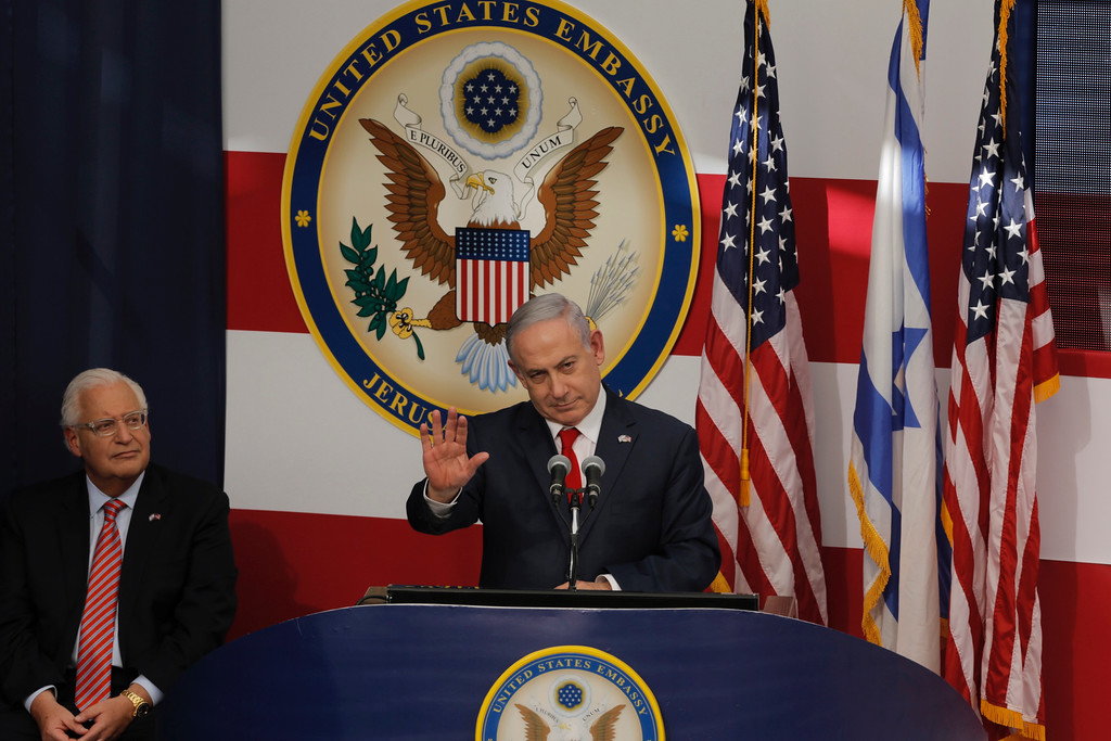 . Israel\'s Prime Minister Benjamin Netanyahu delivers his speech as U.S. ambassador to Israel David Friedman listen, during the opening ceremony of the new U.S. embassy in Jerusalem, Monday, May 14, 2018. Amid deadly clashes along the Israeli-Palestinian border, President Donald Trump\'s top aides and supporters on Monday celebrated the opening of the new U.S. Embassy in Jerusalem as a campaign promised fulfilled. (AP Photo/Sebastian Scheiner)