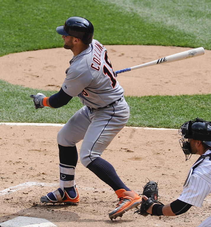 . Detroit Tigers Tyler Collins hits a single during the sixth inning of baseball game against the Chicago White Sox in Chicago on Sunday, June 7,  2015. (AP Photo/Matt Marton)