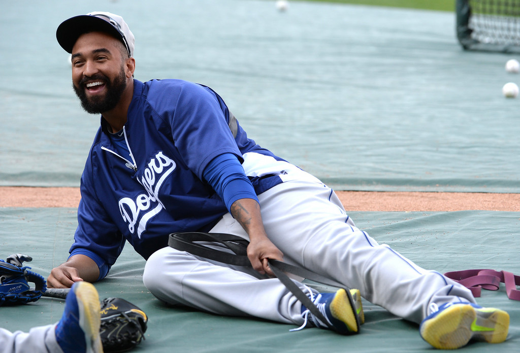 . Los Angeles Dodgers\' Matt Kemp stretches prior to a baseball game against the Los Angeles Angels at Anaheim Stadium in Anaheim, Calif., on Thursday, Aug. 7, 2014.  (Photo by Keith Birmingham/ Pasadena Star-News)
