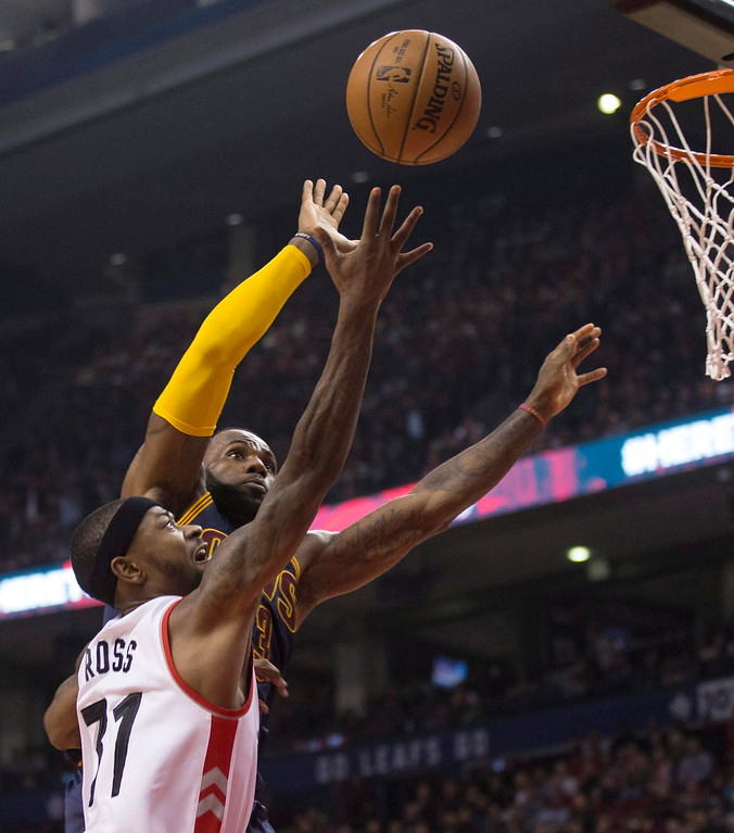 . Toronto Raptors forward Terrence Ross shoots against Cleveland Cavaliers forward LeBron James dduring the first half of an NBA basketball game in Toronto on Friday, Oct. 28, 2016. (Chris Young/The Canadian Press via AP)