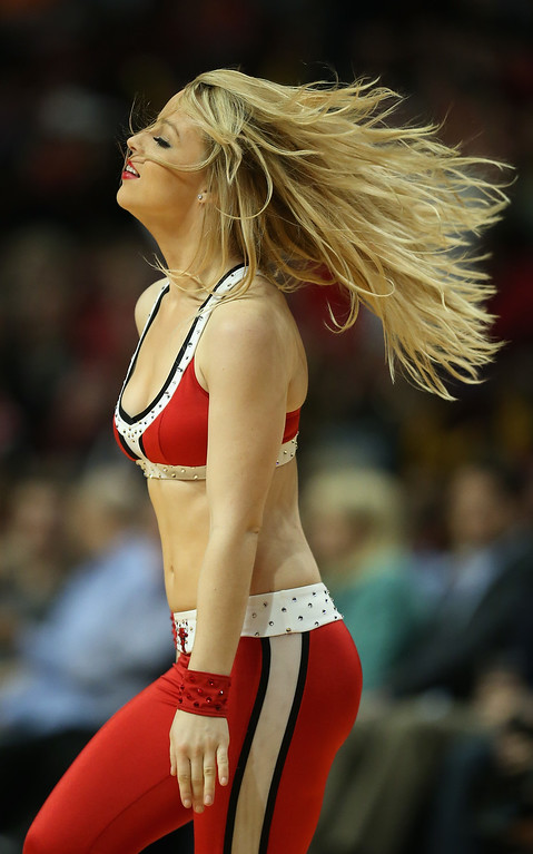 """. A member of the Chicago Bulls dance team \""""The Luvabulls\"""" performs during a break between the Bulls and the Denver Nuggets during a preseason game at the United Center on October 25, 2013 in Chicago, Illinois. The Bulls defeated the Nuggets 94-89. (Photo by Jonathan Daniel/Getty Images)"""