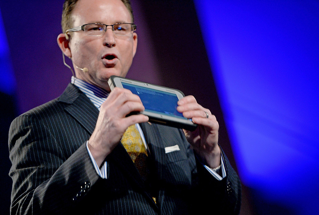 . Panasonic Systems Corporation North America President Rance Poehler holds a 7\' Toughpad FZ-M1, Panasonics thinnest and lightest fully-rugget tablet, at a Panasonic Corporation press event at the Mandalay Bay Convention Center for the 2014 International CES on January 6, 2014 in Las Vegas, Nevada. (ROBYN BECK/AFP/Getty Images)