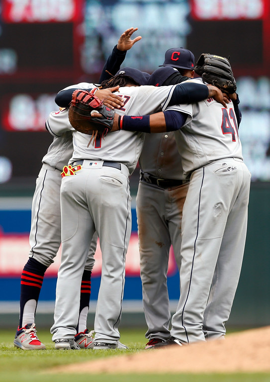 . Cleveland Indians\' players celebrate their 6-2 win over the Minnesota Twins in the a baseball game Thursday, April 20, 2017, in Minneapolis. (AP Photo/Jim Mone)