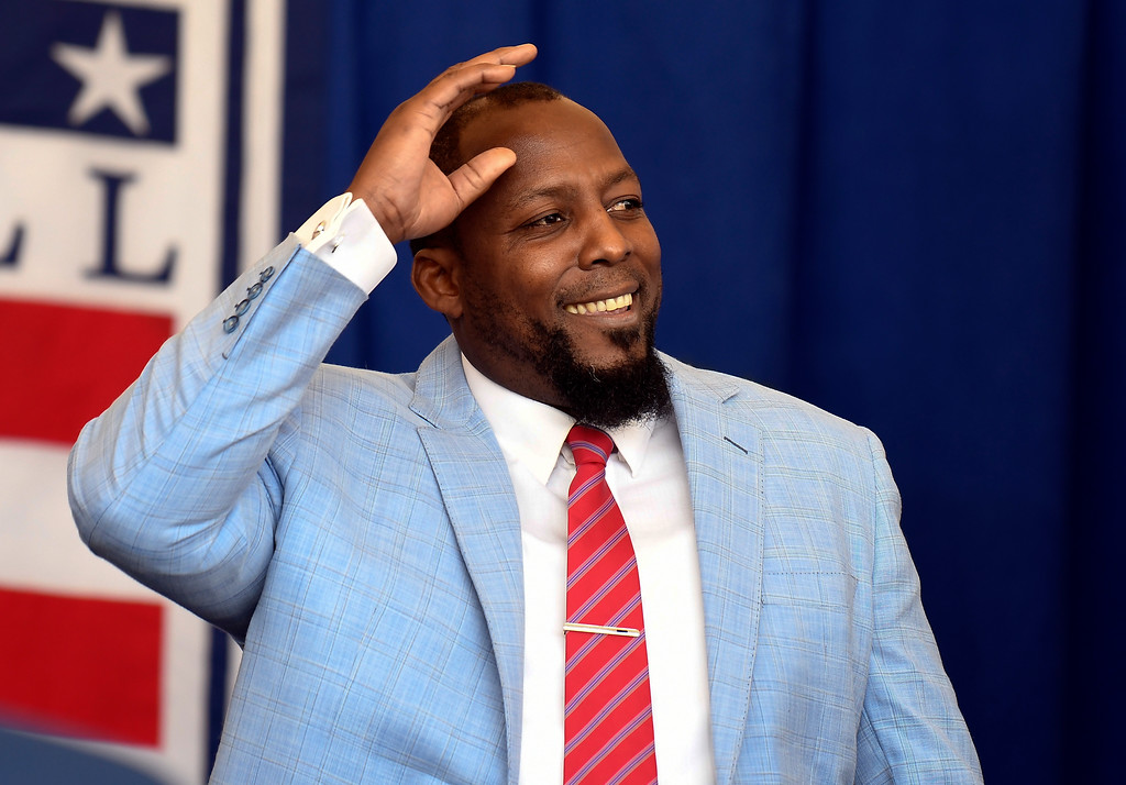 . National Baseball Hall of Fame inductee Vladimir Guerrero is introduced during an induction ceremony at the Clark Sports Center on Sunday, July 29, 2018, in Cooperstown, N.Y. (AP Photo/Hans Pennink)