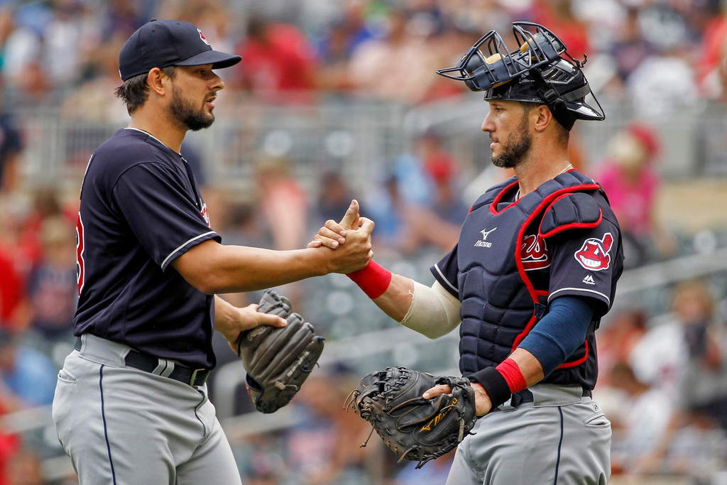 . Cleveland Indians relief pitcher Brad Hand, left, celebrates with Yan Gomes after their 2-0 win in a baseball game against the Minnesota Twins, Wednesday, Aug. 1, 2018, in Minneapolis. (AP Photo/Bruce Kluckhohn)