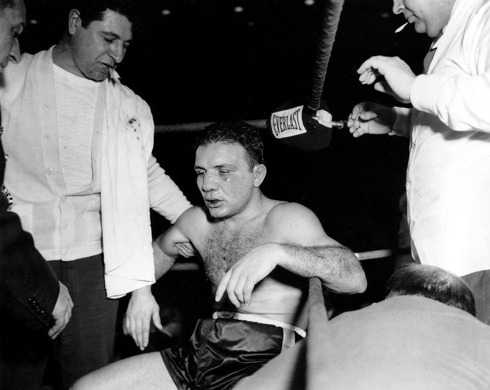 . A defeated Jake LaMotta sags in his corner seconds after removing his gloves during the world middleweight boxing title fight against challenger Sugar Ray Robinson at Chicago Stadium, Ill., Feb. 14, 1951.  Welterweight champion Robinson took the middleweight title in a 13th round TKO.  (AP Photo)