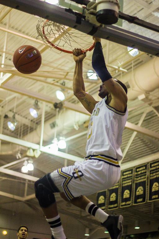 . Mondy gets a slam dunk. Photos by Dylan Dulberg/The Oakland Press