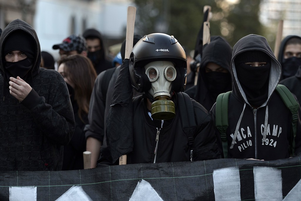 . Masked youths march in Athens on December 6, 2014, during a protest to commemorate the six-year anniversary of the fatal shooting of teenager Alexis Grigoropoulos by a police officer, an event that plunged Greece into weeks of youth riots.  AFP PHOTO / LOUISA  GOULIAMAKI/AFP/Getty Images