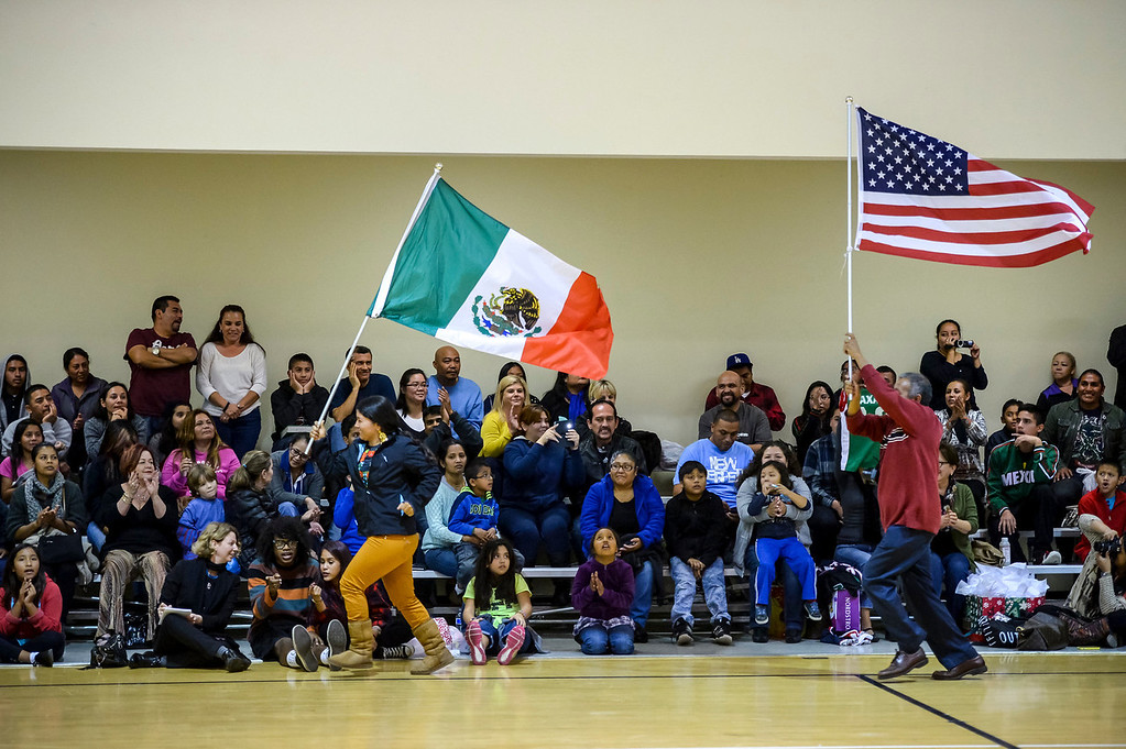 ". Triqui kids basketball team, from the mountainous region of Oaxaca, Mexico, who have been called the ""Barefoot Champions of the Mountain,\"" are known throughout their native Mexico for playing basketball without shoes took on the local Top Flight boys team at the Pacific Boys Lodge in Woodland Hills, CA Wednesday, December 18, 2013.  Fans root for their teams during the first game.  (Photo by David Crane/Los Angeles Daily News)"