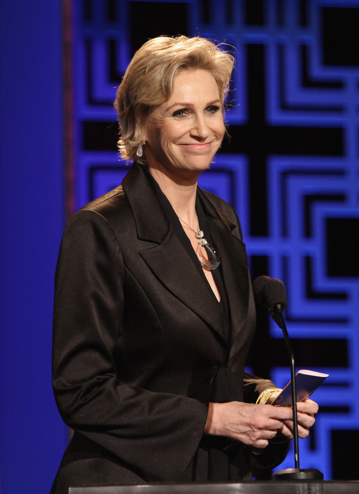 Description of . Actress Jane Lynch speaks onstage during the 2013 WGAw Writers Guild Awards at JW Marriott Los Angeles at L.A. LIVE on February 17, 2013 in Los Angeles, California.  (Photo by Maury Phillips/Getty Images for WGAw)