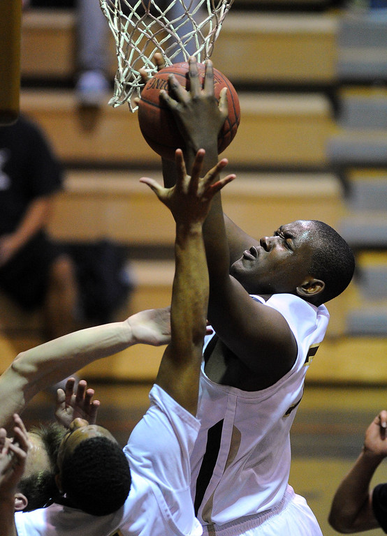 . TORRANCE - 02/15/2013 - (Staff Photo: Scott Varley/LANG) In a CIF Southern Section Division III-AAA second-round boys basketball matchup, West beat Hart 64-55. West\'s Terrell Carter pulls down an offensive rebound.