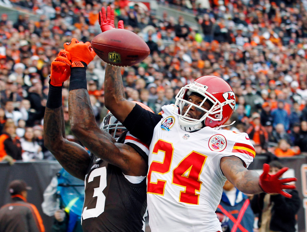 . Kansas City Chiefs cornerback Brandon Flowers (24) breaks up a pass in the end zone intended for Cleveland Browns wide receiver Josh Gordon in the first quarter of an NFL football game, Sunday, Dec. 9, 2012, in Cleveland. (AP Photo/Tony Dejak)
