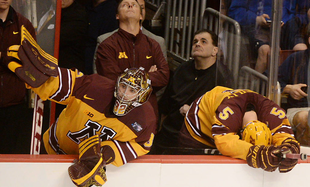 . Minnesota sophomore goalie Adam Wilcox, left, and sophomore defenseman Mike Reilly watch helplessly as Union College celebrate an empty net goal late in third period to seal the game in the NCAA Frozen Four Championship Game at the Wells Fargo Center in Philadelphia, Saturday, April 12, 2014. Union College beat the Gophers 7-4 to claim the national championship. (Pioneer Press: John Autey)