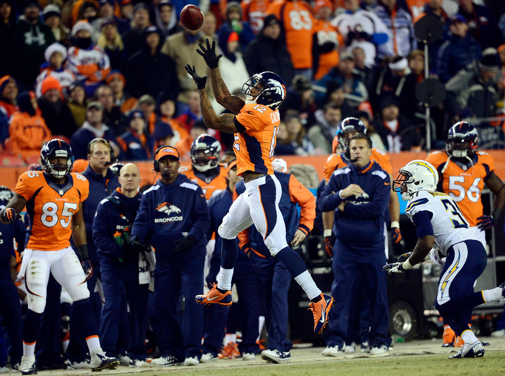. Denver Broncos wide receiver Andre Caldwell (12) goes out of bounds and doesn\'t complete the pass during the first half.  The Denver Broncos vs. the San Diego Chargers at Sports Authority Field at Mile High in Denver on December 12, 2013. (Photo by AAron Ontiveroz/The Denver Post)