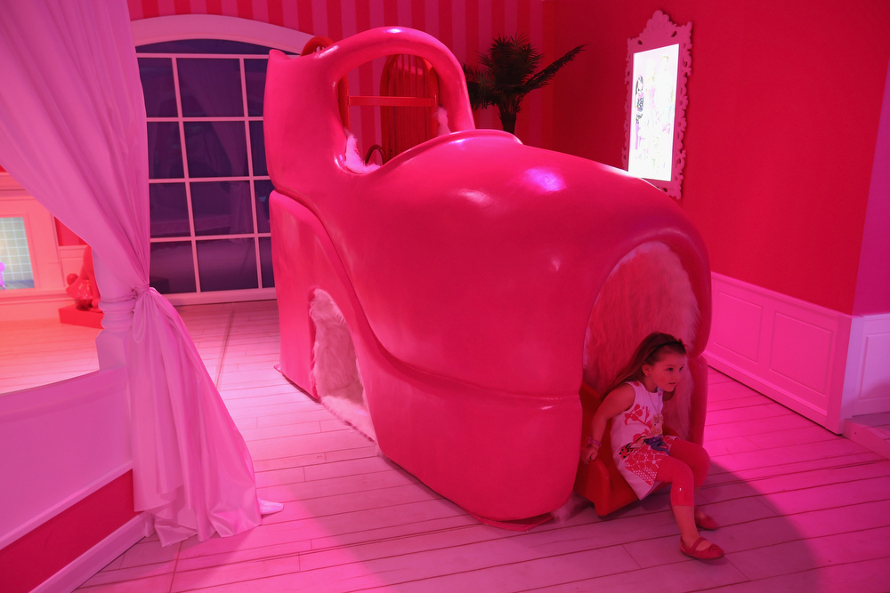 . Selina, 3, plays on a slide in a giant shoe in Barbie\'s bedroom at the Barbie Dreamhouse Experience on May 16, 2013 in Berlin, Germany. The Barbie Dreamhouse is a life-sized house full of Barbie fashion, furniture and accessories and will be open to the public until August 25 before it moves on to other cities in Europe.  (Photo by Sean Gallup/Getty Images)