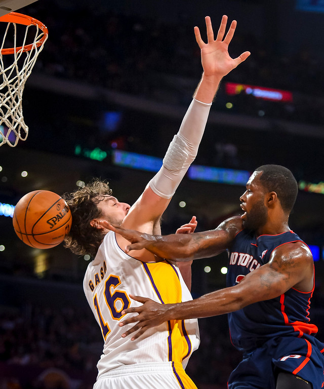 . Detroit�s Rodney Stuckey passes around Lakers� Pau Gasol during second half action at Staples Center Sunday, November 17, 2013.  The Lakers defeated the Detroit Pistons 114-99.  ( Photo by David Crane/Los Angeles Daily News )