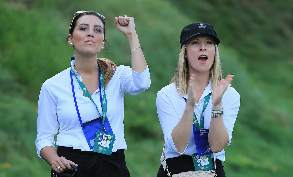. DUBLIN, OH - OCTOBER 03:  Ellie Day (L) and Ruby DeLaet watch the play of the International Team during the Day One Four-Ball Matches at the Muirfield Village Golf Club on October 3, 2013  in Dublin, Ohio.  (Photo by David Cannon/Getty Images)
