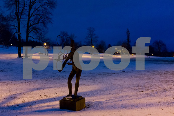 01/17/18 Wesley Bunnell | Staff Chaim Gross' The Juggler sculpture can be seen in Walnut Hill Park on Wednesday evening after a snowstorm spread several inches of snow starting earlier in the day.