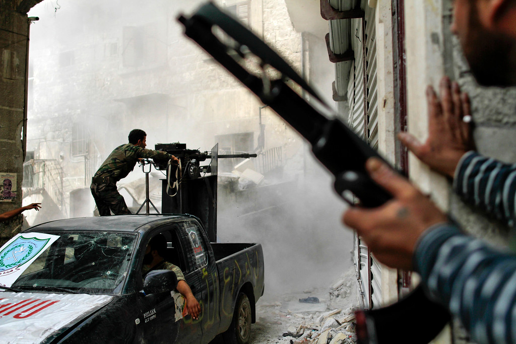 . Free Syria Army (FSA) fighters battle with regime loyalist soldiers to dislodge a sniper from its position overlooking the two main roads in the neighbourhood of Askar in Syria\'s northern city of Aleppo on October 24, 2012. Javier Manzano/AFP/Getty Images