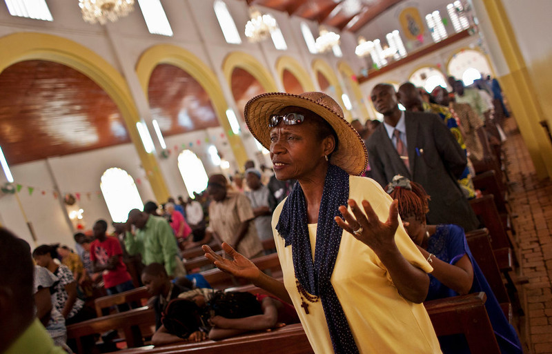 . A churchgoer raises her hands as she prays for peace in the New Year\'s Day morning mass at the Notre Dame Cathedral of the Immaculate Conception in Bangui, Central African Republic, Tuesday, Jan. 1, 2013. President Francois Bozize\'s government is coming under growing threat as rebels vowing to overthrow him rejected appeals from the African Union to hold their advance and try to form a coalition government. (AP Photo/Ben Curtis)