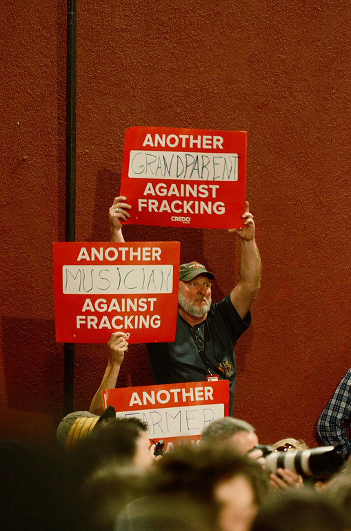 . Erica Miller - The SaratogianFarmers hold anti-fracking signs at the press conference to kick off the Farm Aid 2013 in Saratoga Springs on Sept. 21, 2013 at Saratoga Performing Arts Center.SAR-l-PressConf11