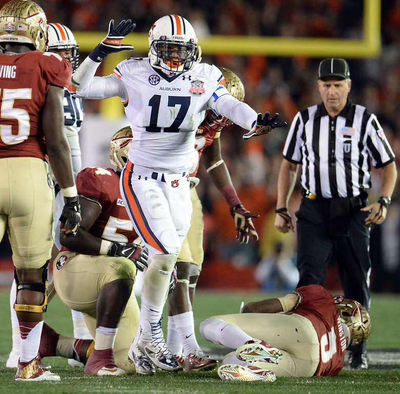 . Auburn linebacker Kris Frost (17) reacts after sacking Florida State quarterback Jameis Winston (5) in the first half of the BCS National Championship game at the Rose Bowl in Pasadena, Calif., on Monday, Jan. 6, 2014. 