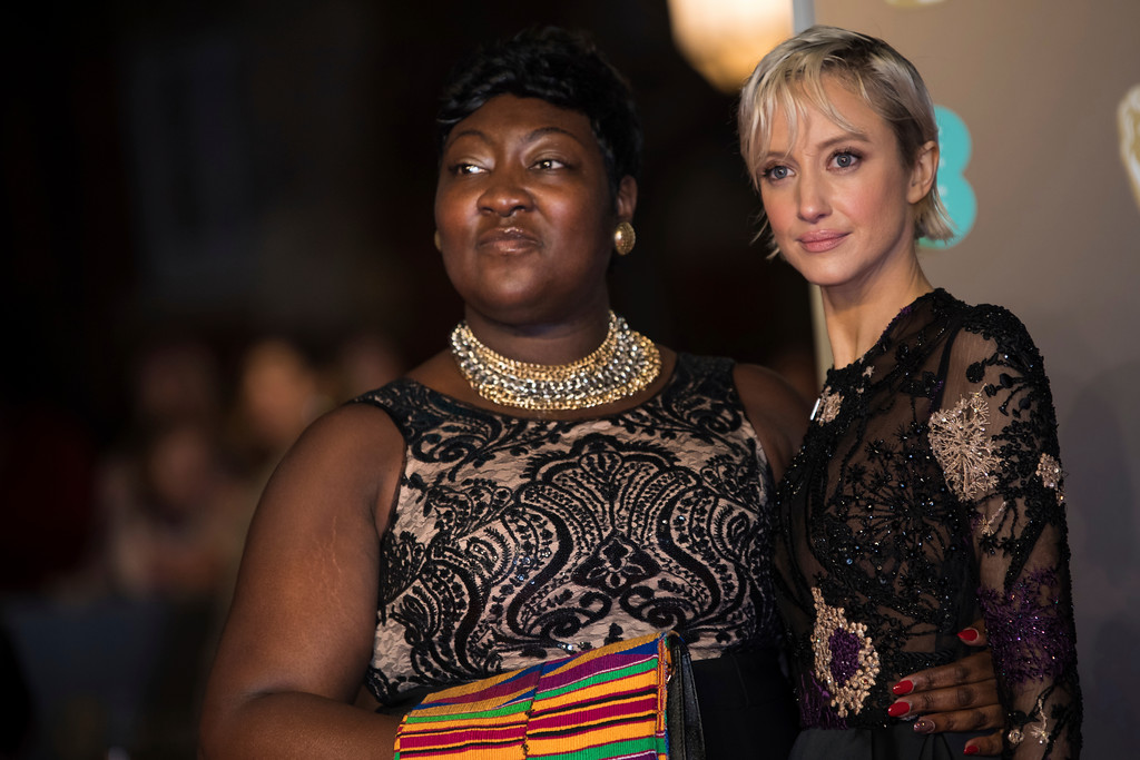 . Time\'s Up activist Phyll Opoku-Gyimah and Andrea Riseborough pose for photographers upon arrival at the BAFTA Awards 2018 in London, Sunday, Feb. 18, 2018. (Photo by Vianney Le Caer/Invision/AP)