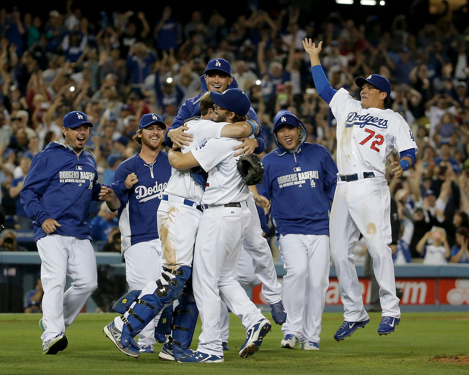. Los Angeles Dodgers starting pitcher Clayton Kershaw celebrates his no-hitter with his teammates against the Colorado Rockies after a baseball game in Los Angeles, Wednesday, June 18, 2014. Kershaw struck out a career-high 15 batters. (AP Photo/Chris Carlson)