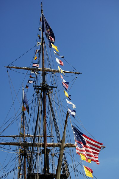 Mast and rigging of the Niagara with signal flags.