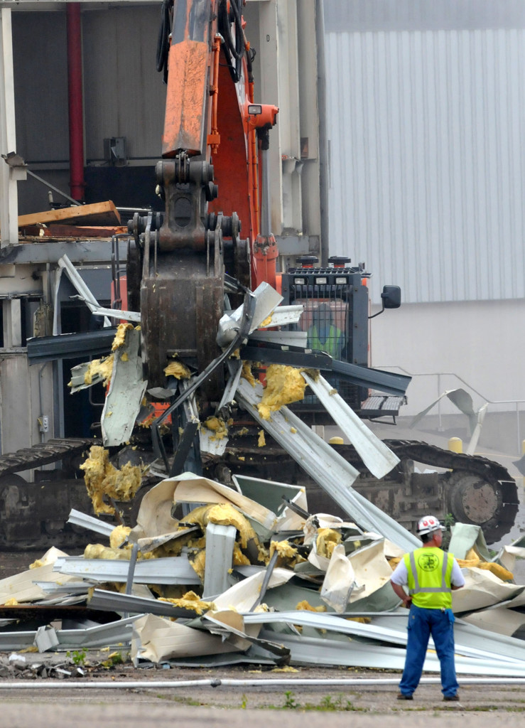. An excavator piles the detritus of the paint shop building aside as demolition of the Ford Plant in Highland Park began Monday morning. The plant closed in December 2011, after 86 years of operation.   (Pioneer Press: John Doman)