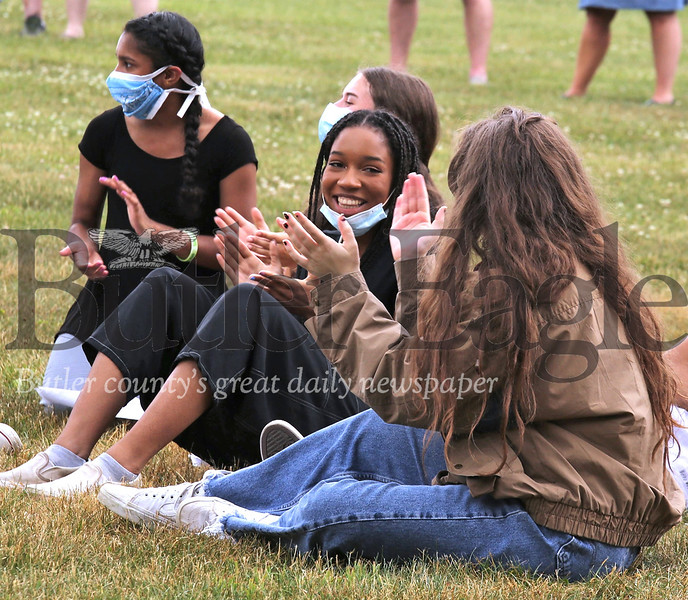 Seneca Valley class of 2020 graduate Cerrina Hagood center and other students clap during a song at Saturday's Come Together civic gathering in Cranberry Community Park Saturday. Hagood was among student speakers to speak about diversity and discrimination during the event which also featured speakers from the township and community members, along with music and an 8 minute and 46 second moment of silence in honor of George Floyd and the Black Lives Matter movement. Seb Foltz/Butler Eagle