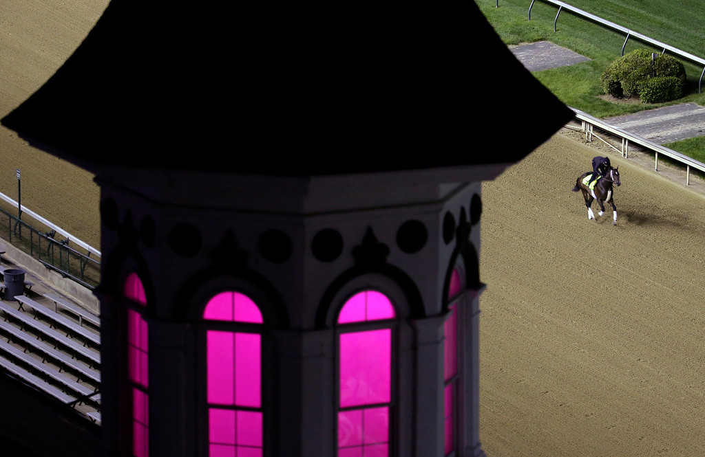 . Exercise rider Emerson Chavez takes Kentucky Derby entrant Commanding Curve for a morning workout during a morning workout at Churchill Downs Friday, May 2, 2014, in Louisville, Ky. (AP Photo/Charlie Riedel)