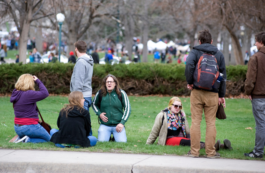 . Denver, CO. - April 20: 4/20 pot rally attendees react to a shooting at the event in Denver\'s Civic Center Park, April 20th, 2013. Two people were shot during Saturday\'s annual 4/20 marijuana rally, held on a day cannabis enthusiasts regard as a holiday called 4/20 drew tens of thousands to Denver\'s Civic Center park. This is the first 4/20 marijuana rally since Colorado voters legalized marijuana use for people 21 and older in November.(Photo By Kholood Eid/Special to The Denver Post)