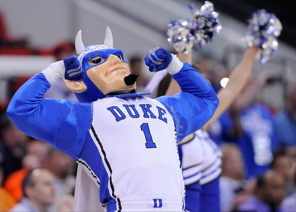 . The Duke Blue Devils mascot flexes in the first half as the Blue Devils take on the Mercer Bears in the second round of the 2014 NCAA Men\'s Basketball Tournament at PNC Arena on March 21, 2014 in Raleigh, North Carolina.  (Photo by Grant Halverson/Getty Images)