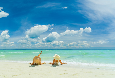 Two women relaxing at the White sand beach