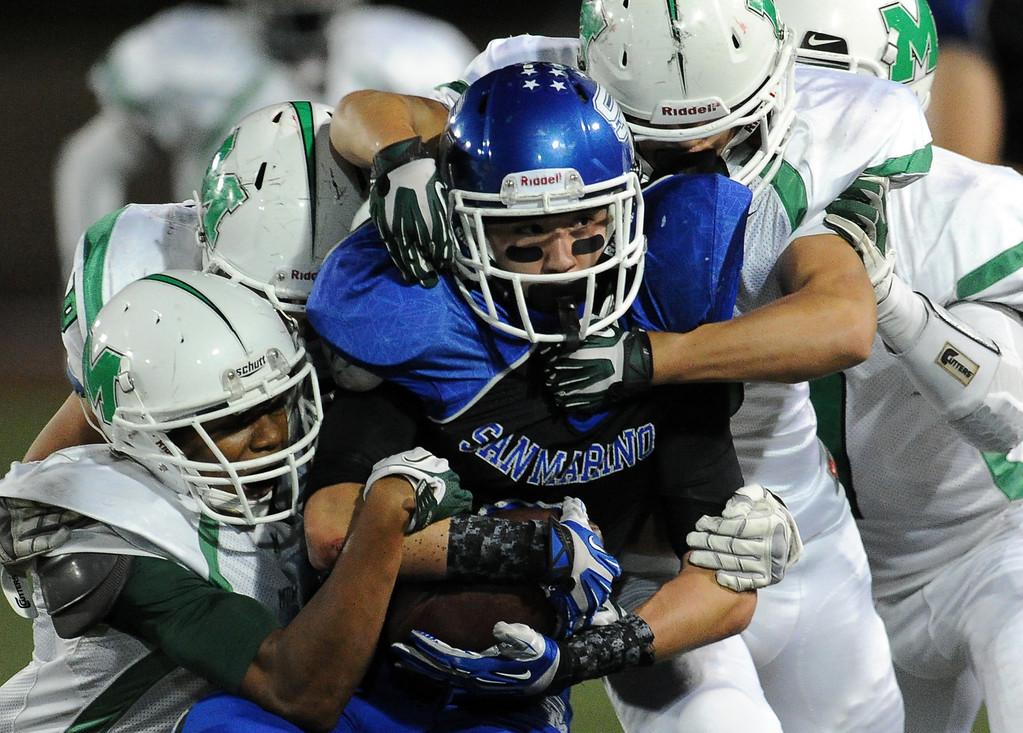 . Monrovia defense tackles San Marino\'s Tyler Spitzer in the first half of a prep football game at Monrovia High School in Monrovia, Calif., on Friday, Nov. 8, 2013.    (Keith Birmingham Pasadena Star-News)