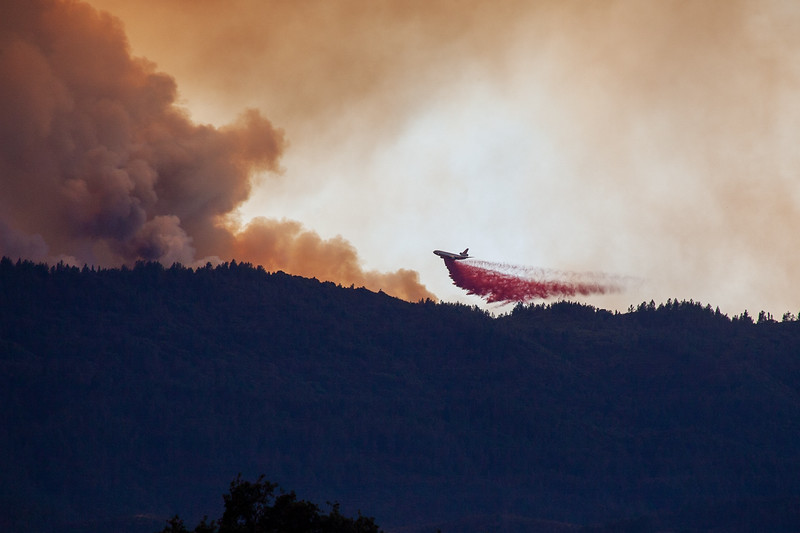 CalFire Air Tanker 912, a DC-10 VLAT, drops a load of fire retardant onto the east side of Cow Mountain where the River Fire has moved into Lake County. Chris Pugh-Ukiah Daily Journal.