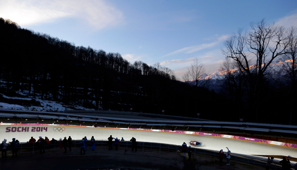 . The doubles team of Alexander Denisyev and Vladislav Antonov from Russia speeds down the track during the men\'s doubles luge at the 2014 Winter Olympics, Wednesday, Feb. 12, 2014, in Krasnaya Polyana, Russia. (AP Photo/Natacha Pisarenko)