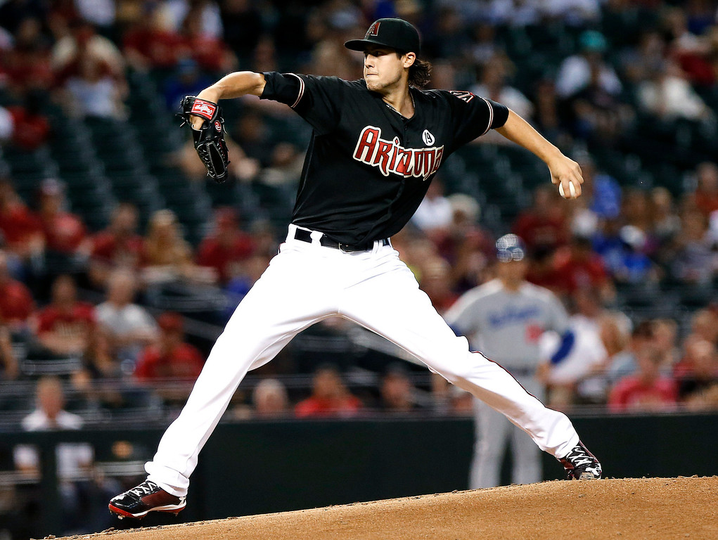 . Arizona Diamondbacks\'Tyler Skaggs delivers a pitch against the Los Angeles Dodgers during the first inning of a baseball game, Wednesday, July 10, 2013, in Phoenix. (AP Photo/Matt York)