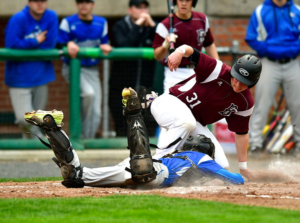 5/1/2019 Mike Orazzi | Staff Bristol Eastern's Carson Sassu (1) tags out Bristol Central's Jacob Santiago (31) at Muzzy Field Wednesday evening.