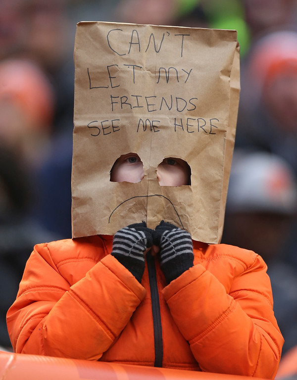 . A Cleveland Browns fan watches in the second half of an NFL football game between the San Diego Chargers and the Cleveland Browns, Saturday, Dec. 24, 2016, in Cleveland. (AP Photo/Aaron Josefczyk)
