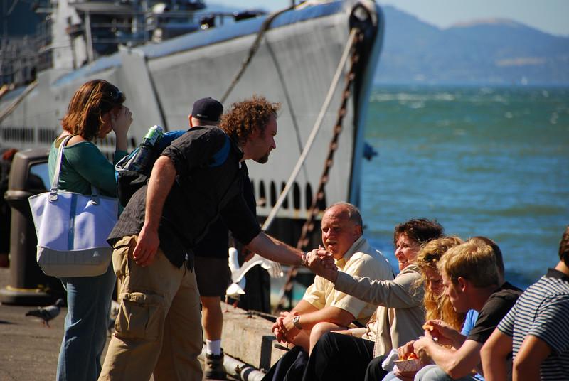 John giving Margo a hand.