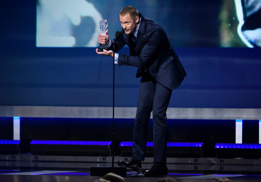 ". Alexander Skarsgard accepts the award for best supporting actor in a movie made for tv or limited series for ""Big Little Lies\"" at the 23rd annual Critics\' Choice Awards at the Barker Hangar on Thursday, Jan. 11, 2018, in Santa Monica, Calif. (Photo by Chris Pizzello/Invision/AP)"