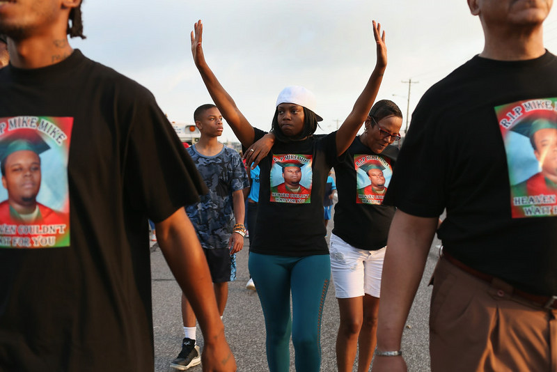 . Nicky Rivers (L) and her mother Alison McSpadden, the aunt of Michael Brown, make their voices heard as they walk through the streets on August 17, 2014 in Ferguson, Missouri. Violent outbreaks have taken place in Ferguson since the shooting death of Michael Brown by a Ferguson police officer on August 9th.  (Photo by Joe Raedle/Getty Images)