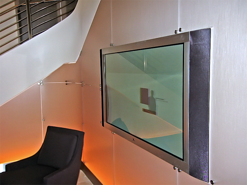"""Yes, another 61"""" plasma that is flush mounted in glass. This one Tim and I set to match the curve of the speakers."""