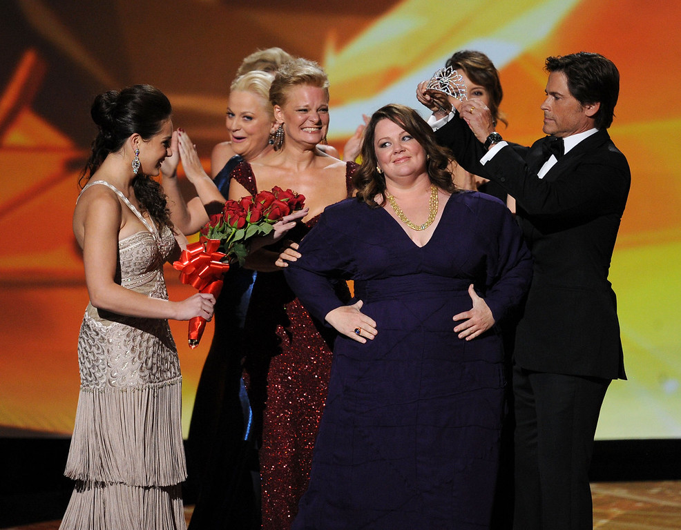 . Actress Melissa McCarthy (C) accepts the Outstanding Lead Actress in a Comedy Series award onstage with Martha Plimpton and Rob Lowe during the 63rd Annual Primetime Emmy Awards held at Nokia Theatre L.A. LIVE on September 18, 2011 in Los Angeles, California.  (Photo by Kevin Winter/Getty Images)