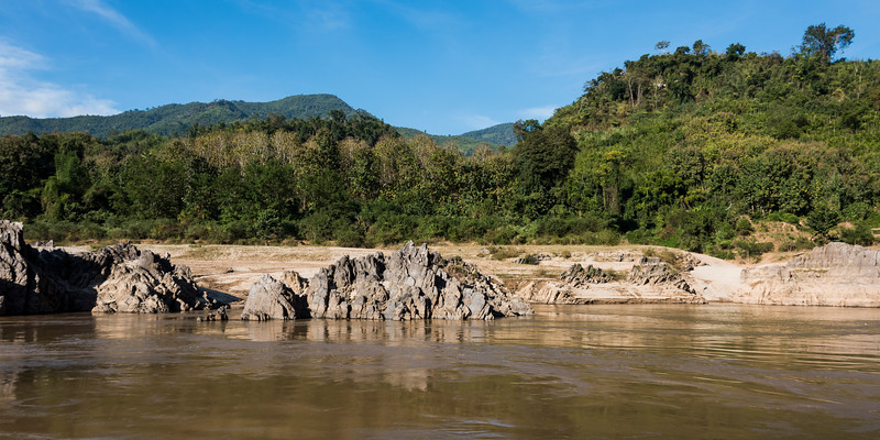 Rocky shoreline of River Mekong, Laos