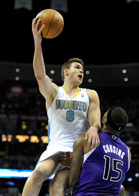 . DENVER, CO. - MARCH 22: Danilo Gallinari (8) of the Denver Nuggets worked above DeMarcus Cousins (15) of the Sacramento Kings in the second half. The Denver Nuggets defeated the Sacramento Kings 101-95 Saturday night, March 23, 2013 at the Pepsi Center. The Nuggets extended its longest winning streak since joining the NBA to 15 games with the win over the Kings. (Photo By Karl Gehring/The Denver Post)
