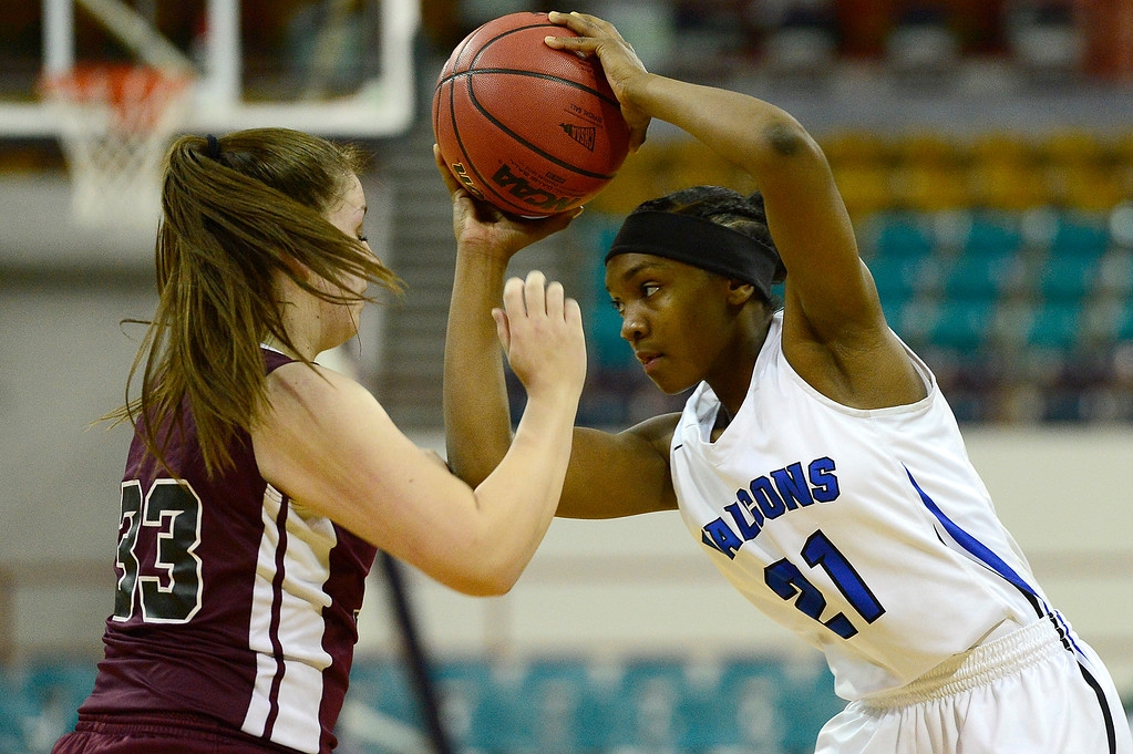 . Highlands Ranch point guard Symone Starks (21) looks for an open teammate around the defense of Horizon guard Savannah Arellano (33) at the Pepsi Center on March 4, 2016 in Denver, Colorado. Highlands Ranch defeated Horizon 65-35 to advance to the semifinals of girls 5A basketball tournament. (Photo by Brent Lewis/The Denver Post)
